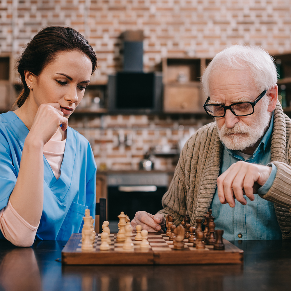 Champon Home Health caregiver playing chess with a client in Stuart, FL