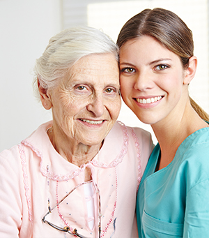 Champion Home Health caregiver keeping a client with Alzheimer's company after returning from hospital in Stuart, FL